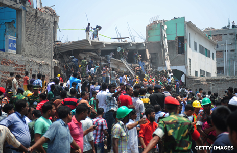 Locals gather at the site of Dhaka building collapse