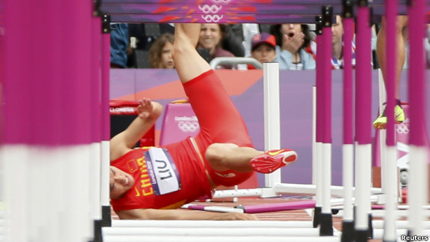 China's Liu Xiang falls at the first barrier in the men's 110m hurdles.