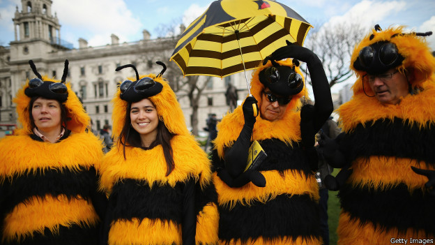 People dressed as bees protest in London against the use of pesticides