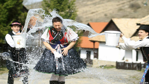 Men throw water onto a woman as part of a festival in Hungary.