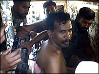 Ramesh being interrogated allegedly by Sri Lanka military (photo: HRW)