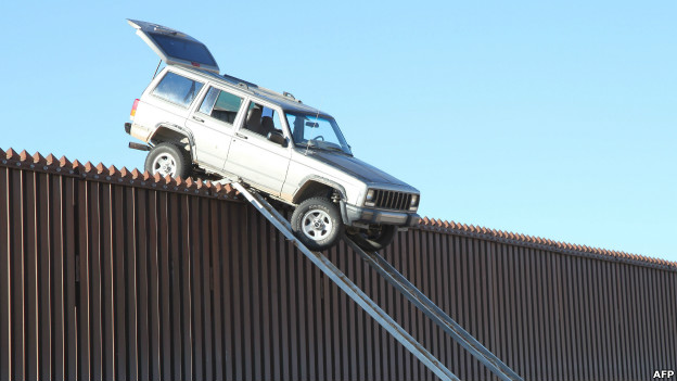 A vehicle stuck on top of the US-Mexico border.