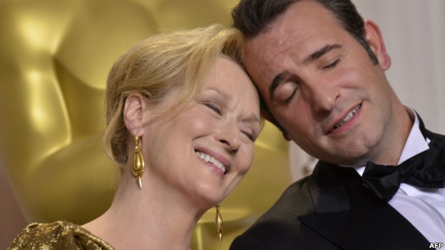 Meryl Streep and Jean Dujardin touching foreheads during the Academy Awards on 26 February.