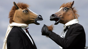 People in horse masks