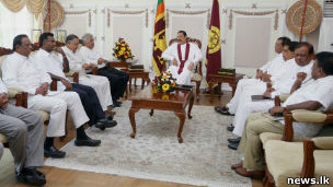 President Rajapaksa with a UNP delegation (file photo)