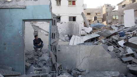 A Palestinian man inspects the damage to a house, after an Israeli airstrike in Jabaliya north Gaza.