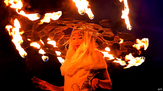An artist plays with fire at the International Fire Festival in Kiev