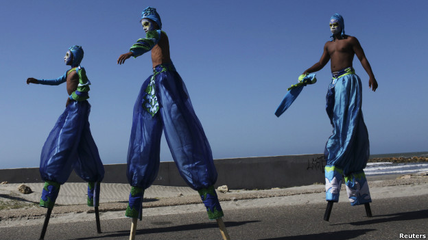 Men on stilts celebrating the Colombian city of Cartagena's independence.