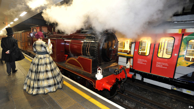 A steam train pulls into Moorgate station.