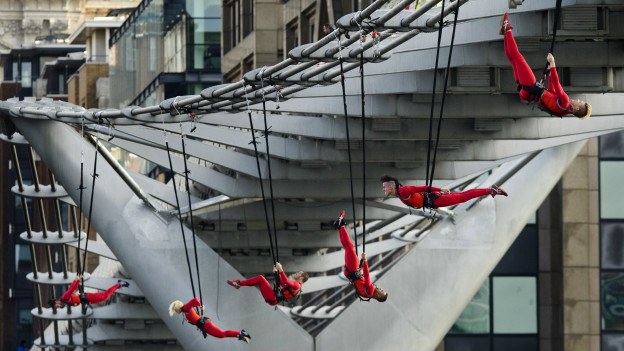 Extreme dancers hang from London's Millennium Bridge as part of the London 2012 Olympic Festival.