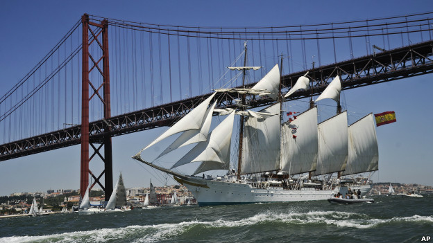 Sailing ship, Juan Sebastian De Elcano, sails up the Tejo River in Lisbon during the 2012 Tall Ships races.