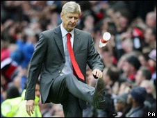 Arsenal manager Arsene Wenger taking out his frustration on a bottle