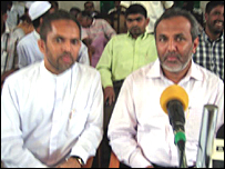 Hisbullah (L) with SLMC leader, Rauff Hakeem (Library photo)