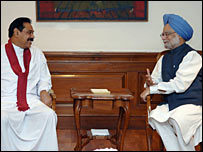 President Mahinda Rajapaksa  at a meeting with Indian Prime Minister Manmohan Singh
