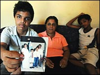 Sandhya Eknaligoda with two sons holding a photo of Prageeth (file photo)