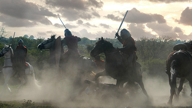 Knights on horseback fight each other in a battle
