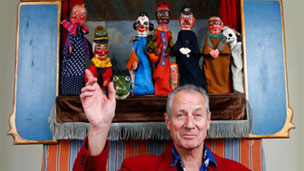 Konrad Fredericks with the Punch and Judy puppets and stage