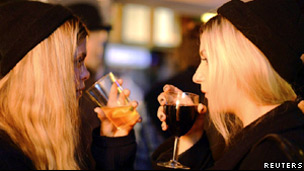 Two young women drinking in a club