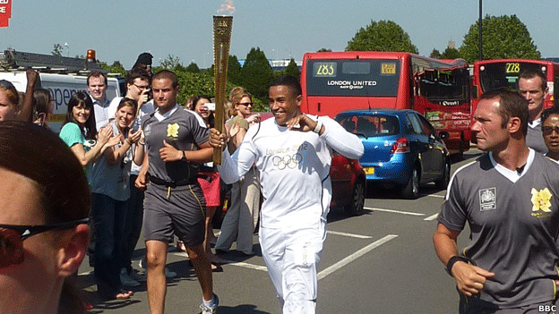 A man carrying the Olympic torch.